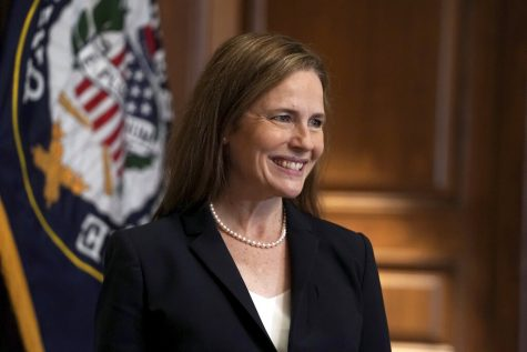 Supreme Court nominee Amy Coney Barrett, meets with Sen. Martha McSally, R-Ariz., Wednesday, Oct. 21, 2020, on Capitol Hill in Washington. (Greg Nash/Pool via AP)