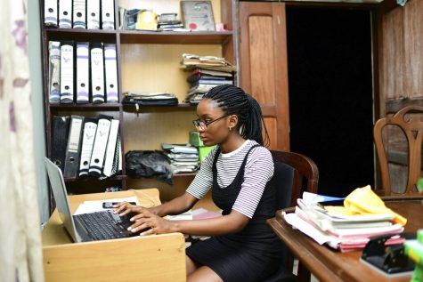 In this photo taken on Tuesday, Oct. 13, 2020, Dodeye Ewa, 16 year old study at the family library in Calabar, Nigeria. The third child is bothered by President Donald Trump