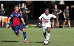 DePaul junior midfielder Patrick Watkins dribbles the ball past a UIC defender in 2019.