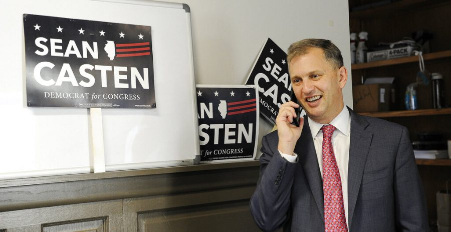 Rep. Sean Casten takes a phone call from his Downers Grove, Ill., office on Wednesday, Nov. 4, 2020.  Casten was elected to a second term after a challenge from Republican Jeanne Ives in historically GOP territory outside Chicago. (Mark Welsh/Daily Herald via AP)