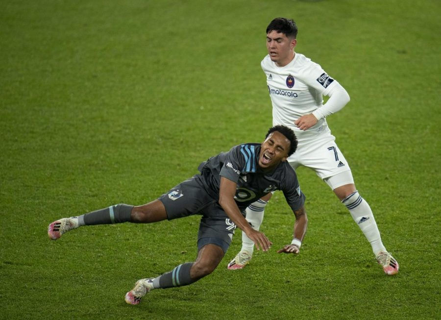 Minnesota United midfielder Marlon Hairston, left, falls after a second-half collision with Chicago Fire attacker Ignacio Aliseda during an MLS soccer match Wednesday, Nov. 4, 2020, at Allianz Field in St. Paul, Minn.