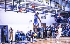 Ahamad Bynum goes up for a dunk during a high school in the 2019-2020 season.