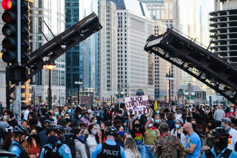 Eric Henry Eric Henry 7:09 PM Today Crowds gather across Trump Tower in Chicago after Joe Biden is declared winner of presidential election.
