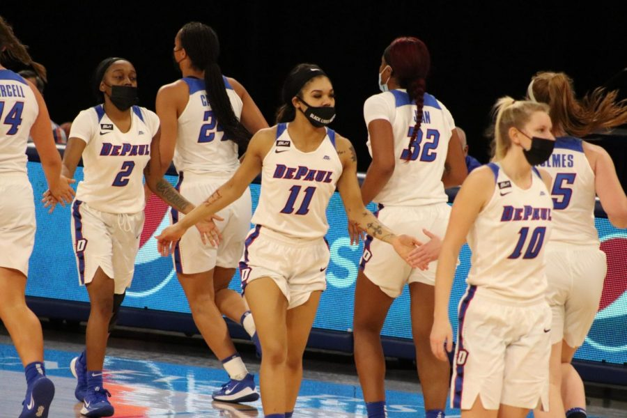 The DePaul women's basketball team shake hands during Monday's game against Chicago State.
