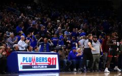 DePaul fans celebrate together during the Blue Demons' game against Texas Tech on Dec. 4, 2019.