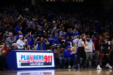 DePaul fans celebrate together during the Blue Demons