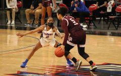 DePaul junior guard Maya Stovall guards a Texas A&M player on Saturday at Wintrust Arena.