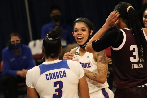 DePaul junior Sonya Morris smiles at fellow teammate senior Deja Church during the Blue Demons