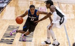 DePaul junior guard Charlie Moore looks to get past a Providence player on Sunday.