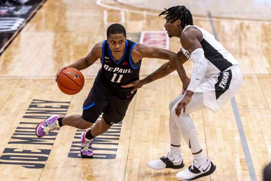 DePaul+junior+guard+Charlie+Moore+looks+to+get+past+a+Providence+player+on+Sunday.+