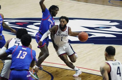 Connecticut guard R.J. Cole (1) drives the ball against DePaul guard Javon Freeman-Liberty (4) during the first half of an NCAA college basketball game Wednesday, Dec. 30, 2020, in Storrs, Conn.