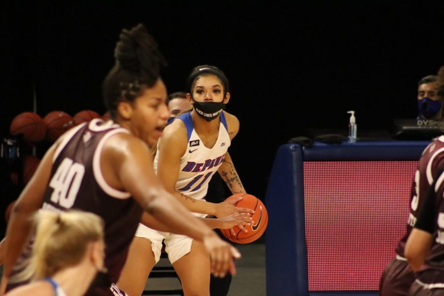 DePaul junior guard Sonya Morris looks for a pass against the Aggies on Saturday.