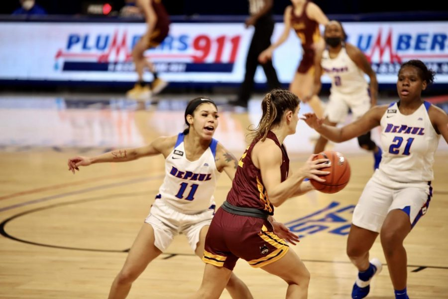 Sonya Morris and Darrione Rogers go out to close a Loyola defender on Sunday at Wintrust Arena.
