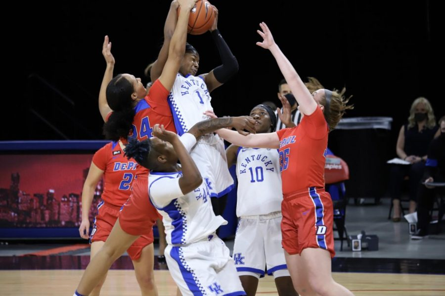 DePaul players go up for a block during the Blue Demons' game against No. 9 Kentucky on Wednesday at Wintrust Arena.