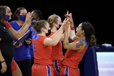 DePaul players celebrate together after defeating No. 9 Kentucky on Dec. 16 at Wintrust Arena.