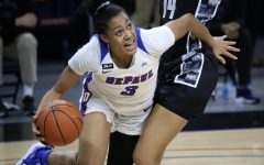 DePaul senior guard Deja Church looks to go around a Georgetown defender on Saturday at Wintrust Arena.