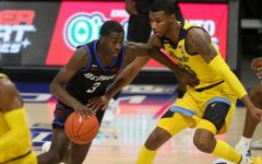DePaul freshman guard Kobe Elvis drives past a Marquette defender on Saturday at Fiserv Forum.