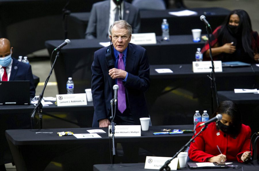 Illinois State Rep. Michael Madigan, D-Chicago, casts his vote for Illinois State Rep. Emanuel