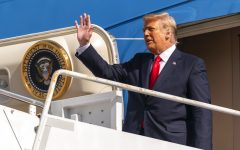 Former President Donald Trump waves as he disembarks from his final flight on Air Force One at Palm Beach International Airport in West Palm Beach, Fla., Wednesday, Jan. 20, 2021. (AP Photo/Manuel Balce Ceneta)