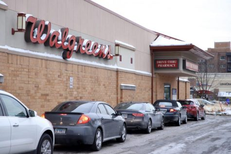 Cars in line at pharmacy drive through at Walgreens in River Forest, one of the few places to offer a Covid-19 vaccine in the area.