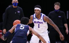 DePaul sophomore forward Romeo Weems stands in front of a UConn player on Monday at Wintrust Arena.