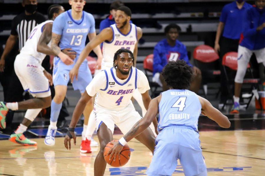 DePaul junior guard Javon Freeman-Liberty defends a Creighton player on Saturday at Wintrust Arena.