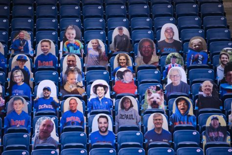 The ball is thrown in the air to start the game between DePaul and Villanova on Jan. 4 at Wintrust Arena. Caption: DePaul has put in cardboard cutouts of fans for home games this season.