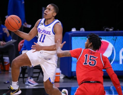 DePaul senior guard Charlie Moore goes up for a layup against St. John