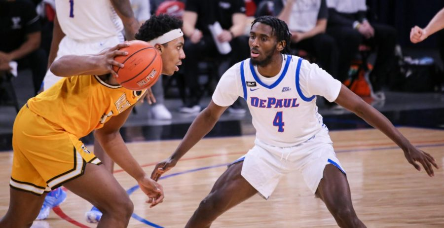 DePaul junior guard Javon Freeman-Liberty stands in front of a Valparaiso player.