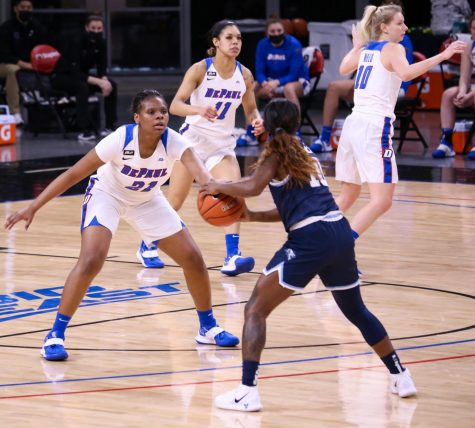 DePaul freshman guard Darrione Rogers stays in front of a Villanova player on Jan. 4 at Wintrust Arena.
