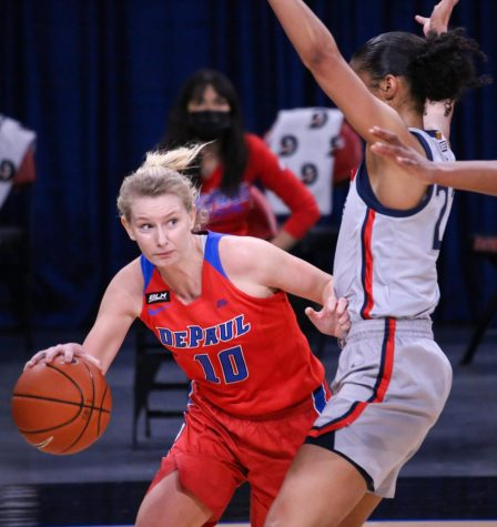 DePaul junior guard Lexi Held looks to go past a UConn defender on Sunday at Wintrust Arena.