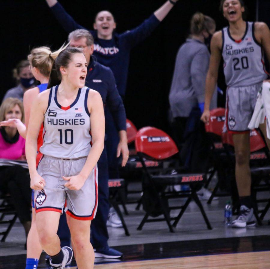 UConn guard Nika Muhl celebrates during the Huskies' 100-67 victory on Sunday at Wintrust Arena.