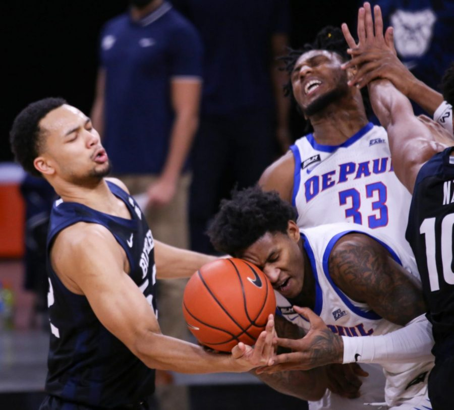 DePaul junior forward Darious Hall goes for a loose ball against Butler on Tuesday at Wintrust Arena.