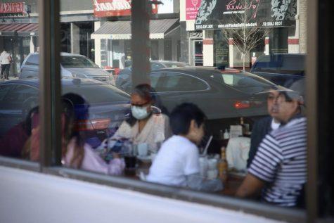 Patrons eat indoors at Cozy Corner, located in Oak Park.