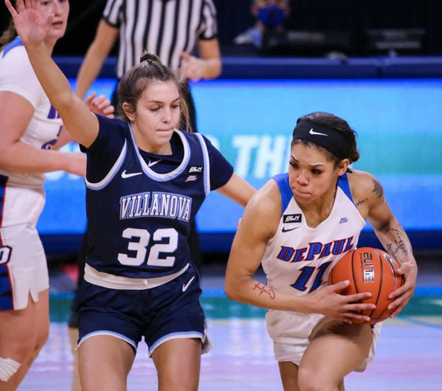 DePaul junior guard Sonya Morris looks to drive past a Villanova defender on Monday at Wintrust Arena.