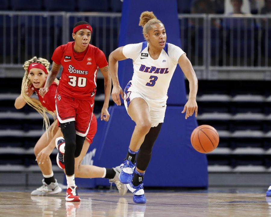 DePaul senior guard Deja Church brings up the ball against St. John's on Wednesday at Wintrust Arena.