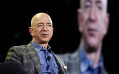 FILE - In this June 6, 2019, file photo Amazon CEO Jeff Bezos speaks at the the Amazon re:MARS convention in Las Vegas. Washington state's richest residents, including Bezos and Bill Gates, would pay a wealth tax on certain financial assets worth more than $1 billion under a proposed bill whose sponsor says she is seeking a fair and equitable tax code. Under the bill, starting Jan. 1, 2022, for taxes due in 2023, a 1% tax would be levied on