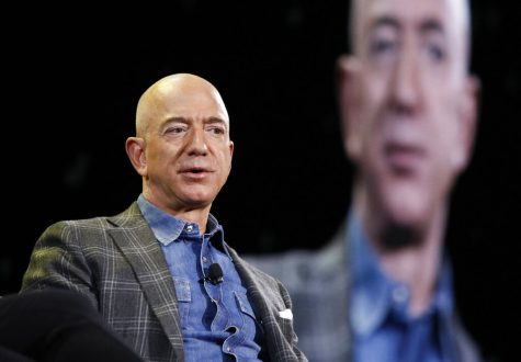 FILE - In this June 6, 2019, file photo Amazon CEO Jeff Bezos speaks at the the Amazon re:MARS convention in Las Vegas. Washington state