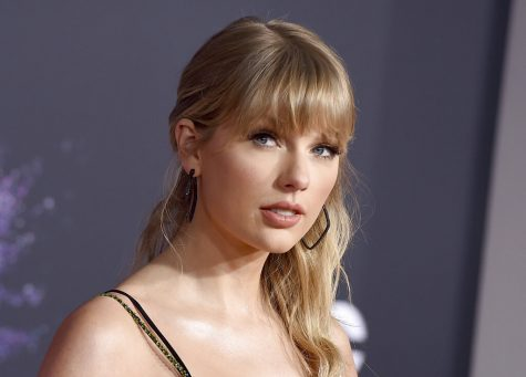 "FILE - This Nov. 24, 2019 file photo shows Taylor Swift at the American Music Awards in Los Angeles. Swift announced online that she's dropping the first of her re-recorded albums. She said ""Fearless: Taylor's Version"" features re-recorded songs from her sophomore album, ""Fearless."" The new set will also contain six never-before released songs. Swift will also release a new version of her song ""Love Story"" from ""Fearless"" on Thursday at midnight. (Photo by Jordan Strauss/Invision/AP, File)"