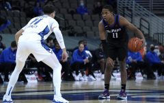 DePaul senior guard Charlie Moore dribbles the basketball against Creighton at the Chi Health Center on Wednesday.