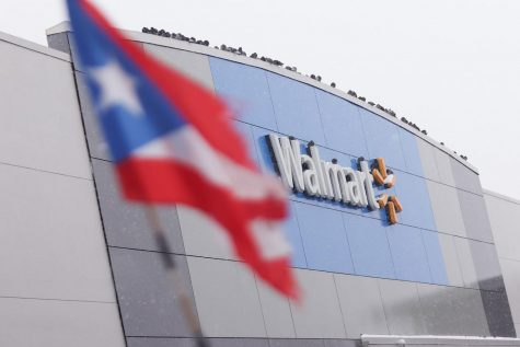 A Puerto Rican flag flies in front of a Walmart located at 4626 W Diversey Ave. that is conducting Covid-19 vaccines.