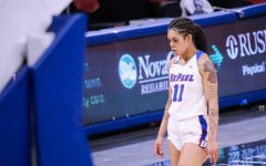 DePaul junior guard Sonya Morris walks off the court disappointed during the Blue Demons 83-72 loss to Creighton on Saturday at Wintrust Arena