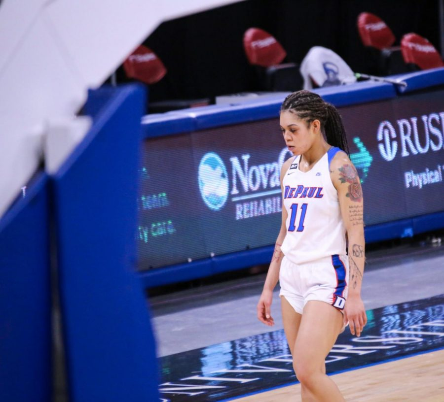 DePaul junior guard Sonya Morris walks off the court disappointed during the Blue Demons' 83-72 loss to Creighton on Saturday at Wintrust Arena