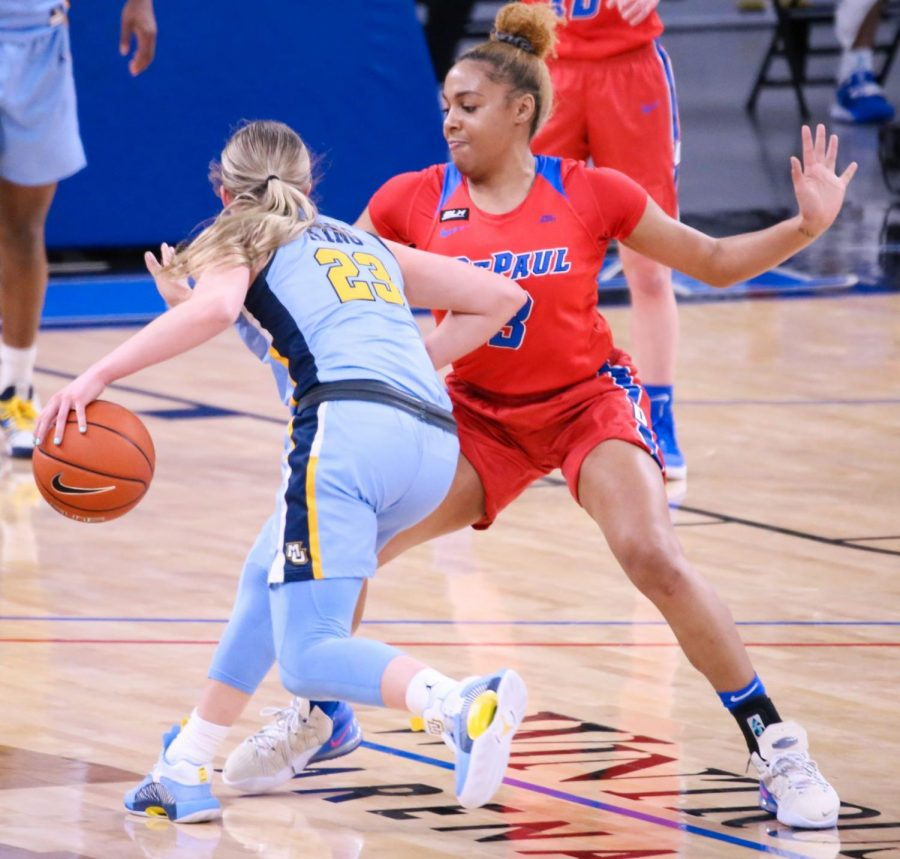 DePaul senior guard Deja Church defends a Marquette player on Wednesday at Wintrust Arena.