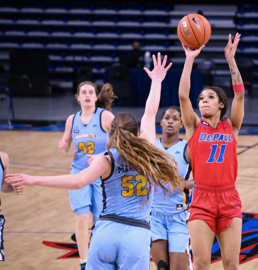 DePaul junior guard Sonya Morris takes a jump shot against Marquette on Wednesday at Wintrust Arena.