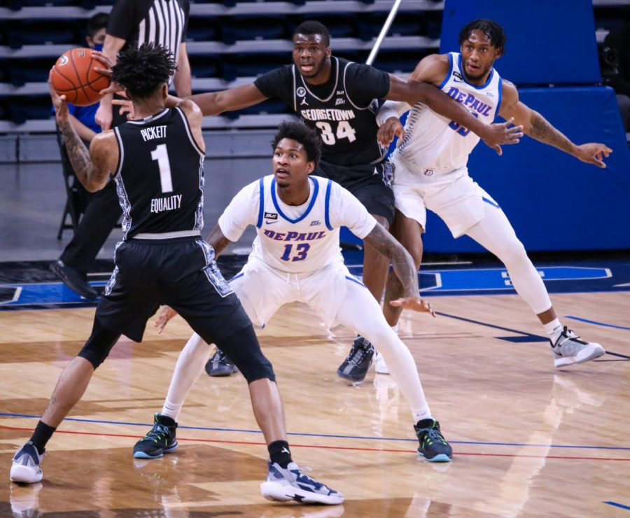 Hall defends a Georgetown player Saturday at Wintrust Arena.