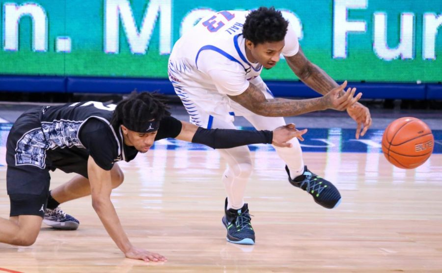 DePaul junior forward Pauly Paulicap goes for a loose ball during a game against Georgetown on Saturday at Wintrust Arena.