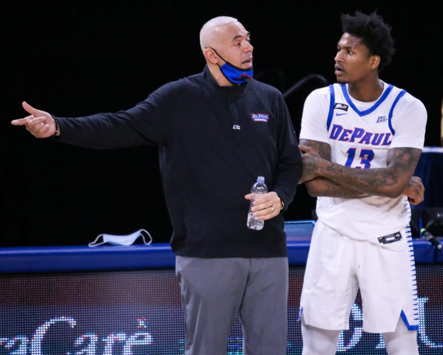 DePaul men's basketball head coach Dave Leitao talks to junior forward Darious Hall during the Blue Demons' game against Georgetown on Saturday at Wintrust Arena.