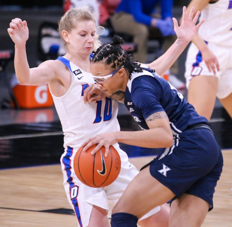DePaul junior guard Lexi Held takes a charge against Xavier on Wednesday at Wintrust Arena.