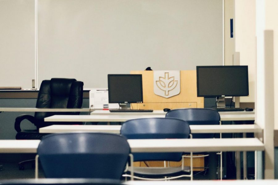 An empty classroom set aside for socially distanced learning at DePaul's Loop campus.